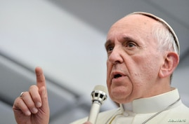 Pope Francis talks with journalists as he flies back Rome following his visit to Brazil July 29, 2013. Pope Francis, in some of the most conciliatory words from any pontiff on gays, said they should not be judged or marginalised and should be integra