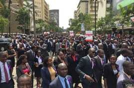 Kenyan lawyers march through streets of Nairobi to protest the alleged extrajudicial killing by police of their colleague, Willie Kimani, his client and their taxi driver, July 6, 2016. (J. Craig/VOA)