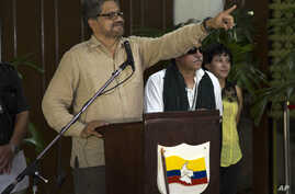 FILE - Ivan Marquez, chief negotiator for the Revolutionary Armed Forces of Colombia (FARC), gestures during a news conference at the close of another round of peace talks with Colombia's governmentin Havana, Cuba, March 27, 2015.