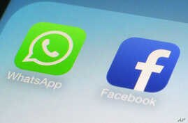 FILE - WhatsApp and Facebook app icons on a smartphone in New York.