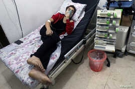 A civilian breathes through an oxygen mask at al-Quds hospital, after a hospital and a civil defence group said a gas, what they believed to be chlorine, was dropped alongside barrel bombs on a neighborhood of the Syrian city of Aleppo, Syria, Aug. 1