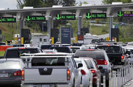 FILE - In this Thursday, May 23, 2013 photo, cars from Canada line up to cross into the U.S. in Blaine, Washington.