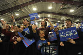 Supporters cheer as Democratic presidential candidate, Sen. Bernie Sanders, I-Vt., arrives during a rally on March 11, 2016, in Summit, Ill