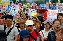 Protesters stage a rally in front of the National Diet building in Tokyo,Japan, Aug. 30, 2015.