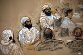 FILE - In this courtroom sketch, alleged 9/11 co-conspirators, left, sit with their legal teams during a hearing in the Camp Justice compound for the U.S. war crimes commission on Guantanamo Bay U.S. Naval Base in Cuba, July 16, 2009. Three of the fi