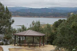 A picnic area is seen along Lake Berryessa with parts of California's newest national monument, Berryessa Snow Mountain, in the background, July 10, 2015.