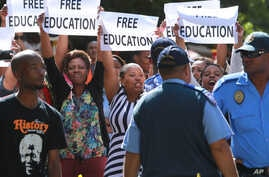 FILE - Protesting university students demand free education during a rally in Cape Town, South Africa, Oct. 22, 2015.