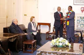 "Former U.N. secretary general Kofi Annan with President Emmerson Mnangagwa at the State House in Harare while fellow members of ""The Elders"" group Mary Robinson, the former president of Ireland, and Lakhdar Brahimi, an Algerian career diplomat look o"