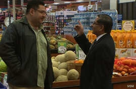 Todos Supermarket founder and CEO Carlos Castro, right, says Hispanic political clout is growing in Prince William County, February 2016. (S. Baragona/VOA)