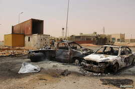FILE - Vehicle wreckages are seen after a suicide car bomber blew himself at a checkpoint near Misrata, Libya, May 21, 2015.