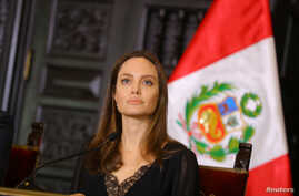 FILE - U.N. Refugee Agency's special envoy Angelina Jolie attends a news conference at the government palace in Lima, Peru, Oct. 23, 2018.