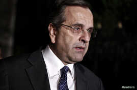 Greece's Prime Minister Antonis Samaras addresses journalists outside the Presidential palace in Athens, Nov. 3, 2014.