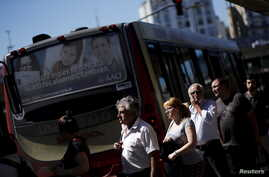 People line up to get on the bus at 'Constitucion' station in Buenos Aires, Argentina, March 31, 2016.