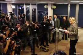 France's far-right National Front political party leader Marine Le Pen attends a news conference after the close of polls in France's second round Departmental elections of local councillors at their party's headquarters in Nanterre, near Paris, Marc