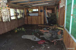 A damaged house is seen after a tsunami hit the Venga village in Solomon Islands, February 6, 2013.