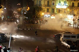 Tear gas fired by riot police at protesters fill the air during clashes at Talaat Harab square in downtown Cairo, Nov. 26, 2013.