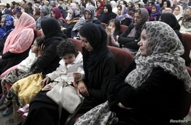 Women and children attend the Ahmadiyya Muslim Community USA members prayer vigil for the victims of Wednesday's massacre at the San Bernardino's Baitul Hameed Mosque in Chino, Calif., Dec. 3, 2015.