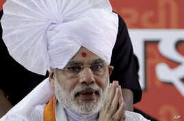Gujarat Chief Minister Narendra Modi greets people during the first day of his fast in Ahmadabad, India, Sept. 17, 2011.