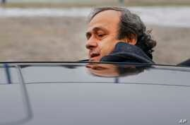 FILE - UEFA President Michel Platini is seen getting into a car in a Jan. 19, 2015, photo.