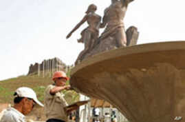 """North Korean workers prepare the unveiling of the """"African Renaissance Monument"""" in Dakar, Senegal, 02 Apr 2010"""