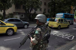 A soldier stands in guard on a street, before a meeting with Brazil's President Michel Temer and local authorities about the implementation of a decree that has placed the military in charge of Rio's state security, at the Guanabara palace in Rio de ...