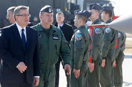 Poland's President Bronislaw Komorowski,left, and  the commander of Poland's Air Force, Gen. Lech Majewski  visit  Lask airbase, central Poland, March 11, 2014.