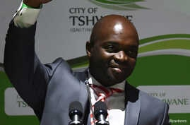 Solly Msimanga waves to his supporters after being officially installed as the mayor for the City of Tshwane, South Africa, Aug. 19, 2016.