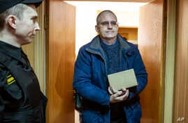 Paul Whelan, a former U.S. Marine, who was arrested in Moscow at the end of last year, arrives for a hearing in a court in Moscow, Russia, Feb. 22, 2019.