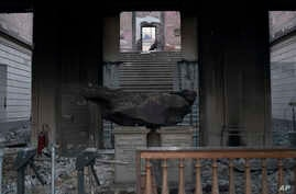 A meteorite on exhibit is seen inside the entrance of the National Museum after an overnight fire in Rio de Janeiro, Brazil, Sept. 3, 2018.