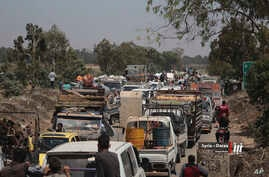 This photo provided by Nabaa Media, a Syrian opposition media outlet, shows people in their vehicles fleeing from Daraa, southern Syria, June 28, 2018. Government forces are on the offensive against insurgents as more people fled their homes, where t