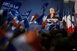 Far-right candidate for the presidential election Marine Le Pen speaks during a campaign meeting in Arcis-sur-Aube, near Troyes, France, April 11, 2017. Le Pen argues that Muslim immigration and economic globalization are destroying France's identity...