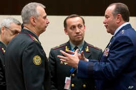 NATO's Supreme Allied Commander Europe U.S. General Philip M. Breedlove (R) speaks with Ukraine's acting Defense Minister Mykhailo Koval (2nd L) during a meeting of NATO defense ministers in the format of the North Atlantic Council with Non-ISAF cont