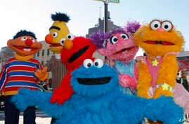 FILE - Characters from Sesame Street Live appear on the street by Madison Square Garden to celebrate the 30th anniversary of the live touring stage shows based on the PBS television series in New York, Thursday, Feb. 4, 2010.