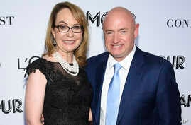 FILE- Politician and gun control advocate Gabrielle Giffords and husband, retired astronaut Mark Kelly, attend the Glamour Women of the Year Awards at Spring Studios in New York.,  Nov. 12, 2018.