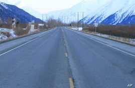 FILE - Seward Highway near Portage, Alaska. The Great Alaska Earthquake on March 27, 1964, opened fissures on the highway at the head of Turnagain Arm and destroying nearby bridges and railroad tracks.