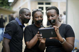 Journalists with tape on their mouths gather on the occasion of World Press Freedom Day, Bujumbura, Burundi, May 3, 2015.