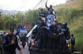 Members of the Honduran police arrive at their headquarters to take part in a strike to demand higher wages and rest after working extra hours due to protests caused by the delay in vote counting in the general election, in Tegucigalpa, Honduras, Dec