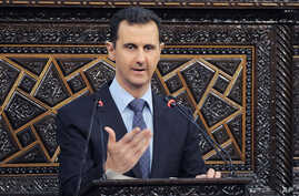 In this photo released by the Syrian official news agency SANA, shows Syrian President Bashar Assad, as he delivers a speech at the parliament in Damascus, June 3, 2012.