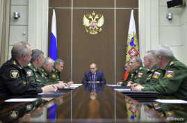 Russian President Vladimir Putin, center, chairs a meeting on the defense industry at the Bocharov Ruchei state residence in Sochi, Russia, Nov. 10, 2015.