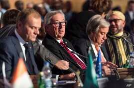 European Commission President Jean-Claude Juncker, center, and European Council President Donald Tusk, left, attend a meeting at an EU Africa summit in Abidjan, Ivory Coast, Nov. 29, 2017.