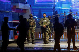 Afghan security forces arrive at the site of a suicide bomb attack in Kabul, Afghanistan, Nov. 20, 2018.