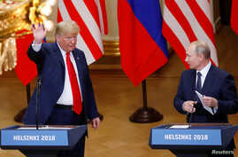 U.S. President Donald Trump and Russian President Vladimir Putin react at the end of the joint news conference after their meeting in Helsinki, Finland, July 16, 2018.