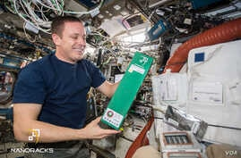 Astronaut Jack Fischer on the International Space Station with the experiment from the Beijing Institute of Technology.