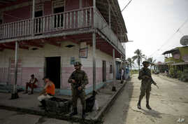 FILE - Panamanian border police patrol a street in Puerto Obaldia near the Colombian border, in Panama, Sept. 16, 2015.