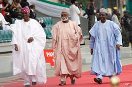 FILE- In this Sunday, May. 29, 2011 file photo Former Nigerian Presidents, Ernest Shonekon, left, Gen Abdulsalam Abubukar, centre, Gen Yakubu Gowon, third left arrived for the inauguration ceremony of former Nigeria President Goodluck Jonathan at the