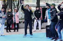 Seoul, Korea residents and tourists learn the dance moves in the Gangnam Style music video.