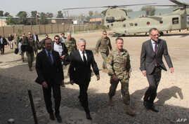 U.S. Defense Secretary Jim Mattis, second left, arrives at NATO's Resolute Support mission in Kabul, Sept. 7, 2018. Mattis landed in Kabul for an unannounced visit to war-torn Afghanistan, adding his weight to a flurry of diplomatic efforts to bring