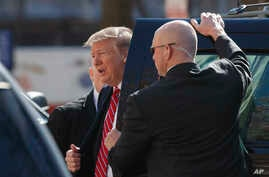 President Donald Trump steps from his motorcade vehicle as he arrives to attend service at Saint John's Church in Washington, Sunday, March 17, 2019.