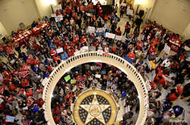 Teachers pack the state Capitol rotunda to capacity, on the second day of a teacher walkout, to demand higher pay and more funding for education, in Oklahoma City, Oklahoma, U.S., April 3, 2018.