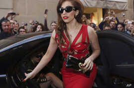 Lady Gaga arrives at the Versace atelier in Milan, Italy, Oct. 1, 2012.